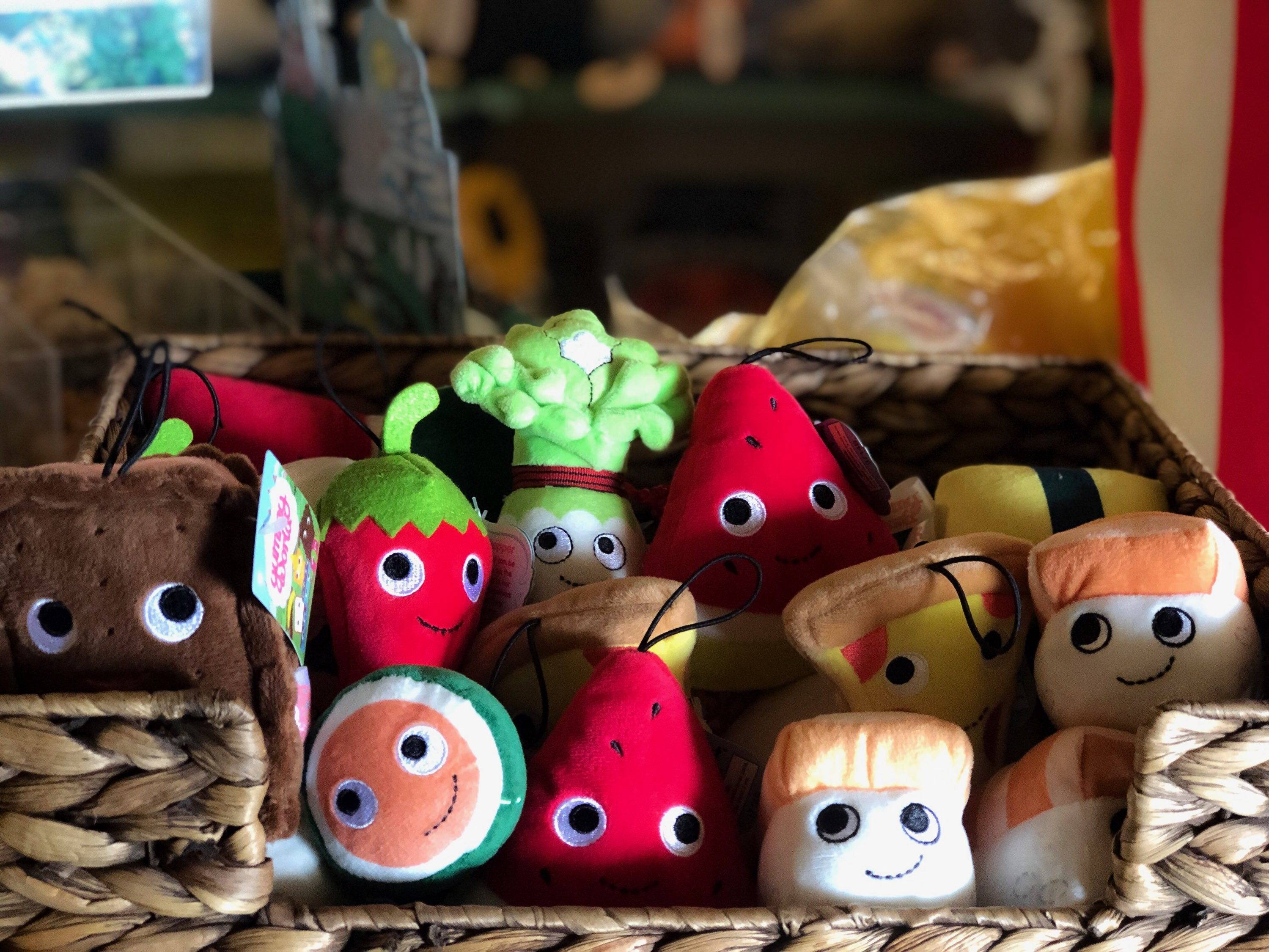 A selection of plush toys in the shape of different types of food.