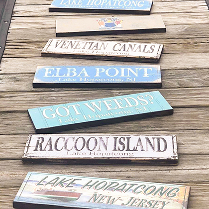 A variety of lake signs laid out on a dock.