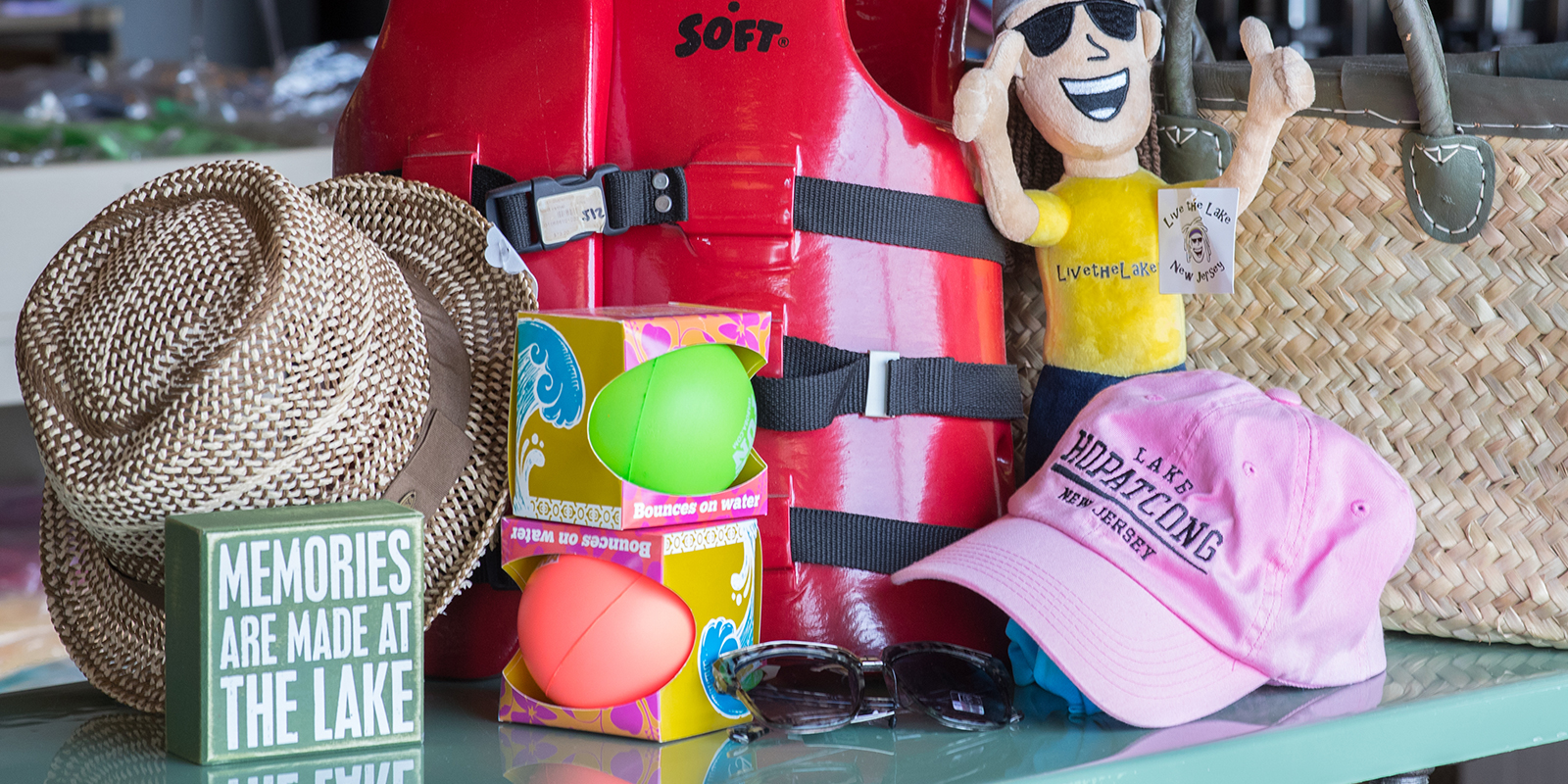 Various items including a life jacket, toys, and hat